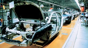 Cars being manufactured on a production line