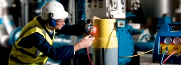 Image to show BOC refrigerant technician recovering refrigerant product from a chiller pack.