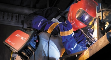 Man welding using boc welding gas and wearing boc welding mask